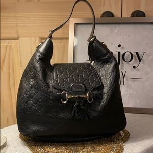 Genuine Gucci embossed leather equestrian bag.